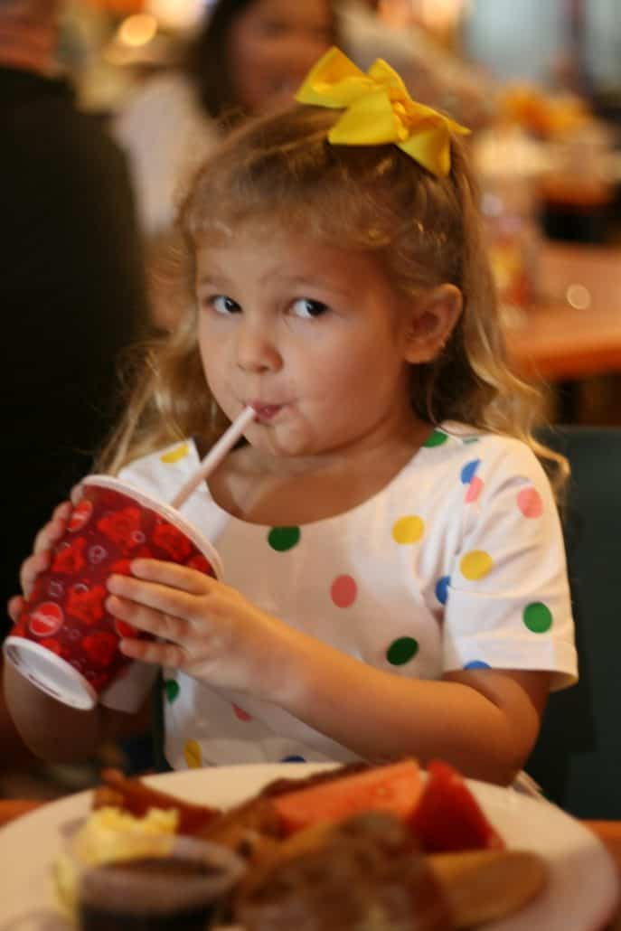 Little girl sipping on a straw at PCH Grill