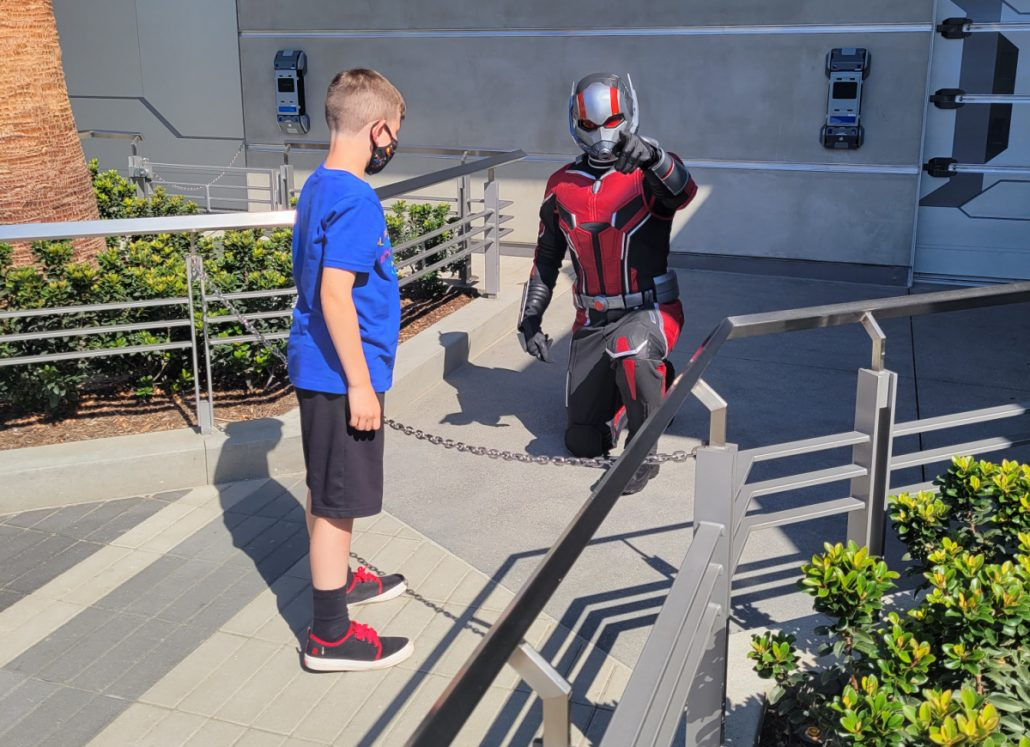 Child standing with Ant-Man in Avengers Campus Disneyland