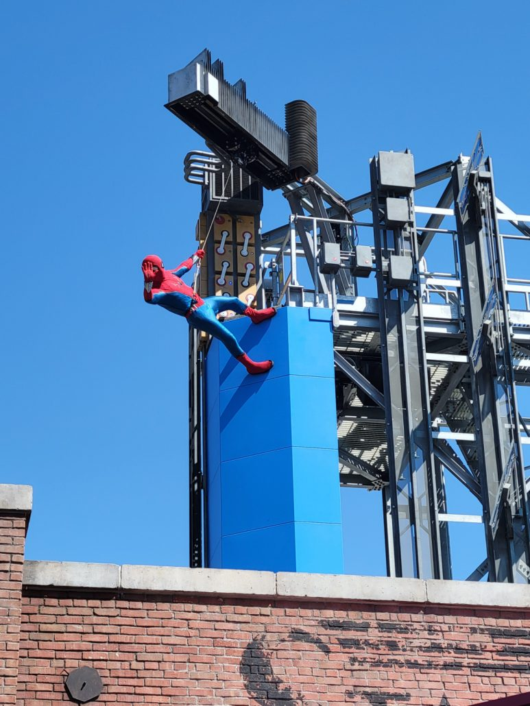 Spider-Man character greeting guests on the rooftops