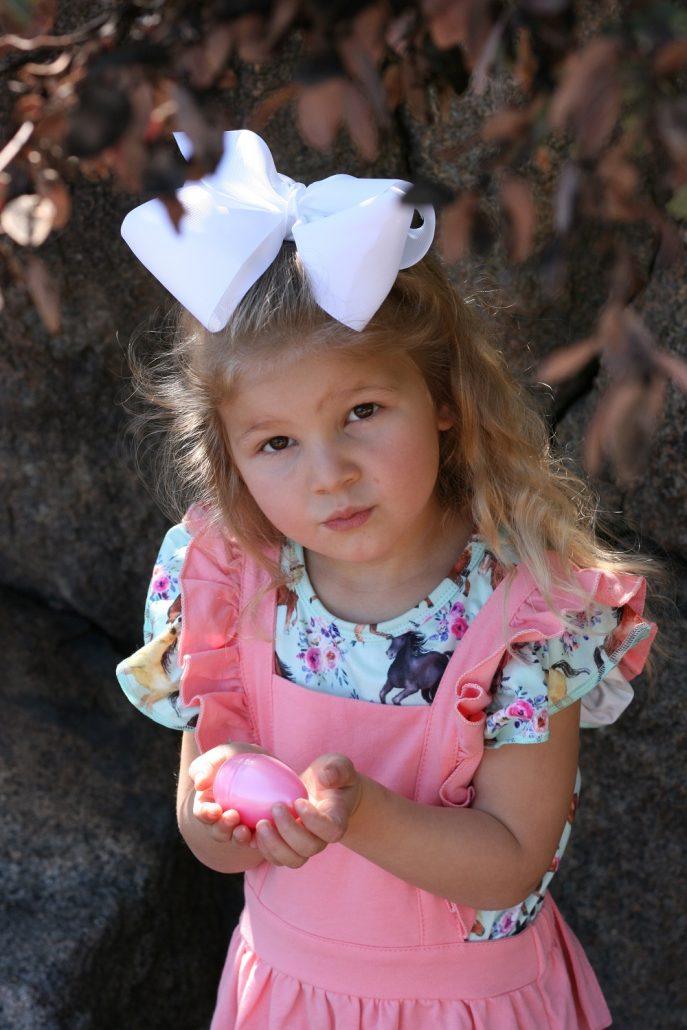 Little girl holding an Easter egg in her hands