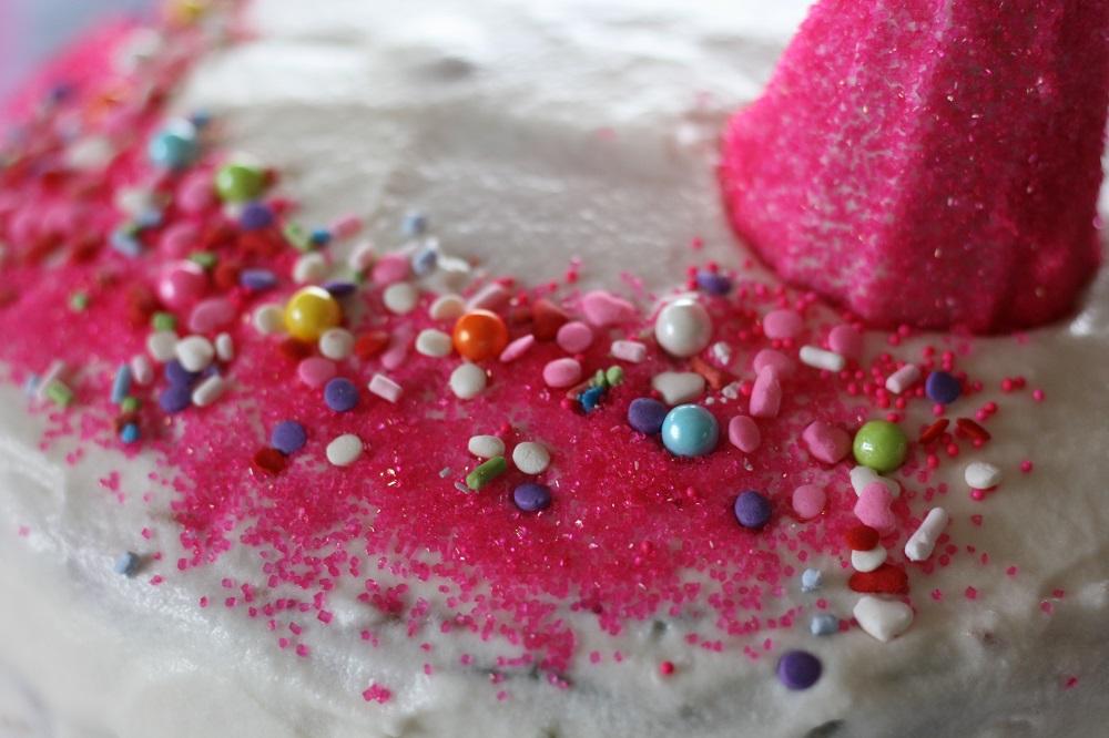 Close up of homemade unicorn birthday cake with sprinkles