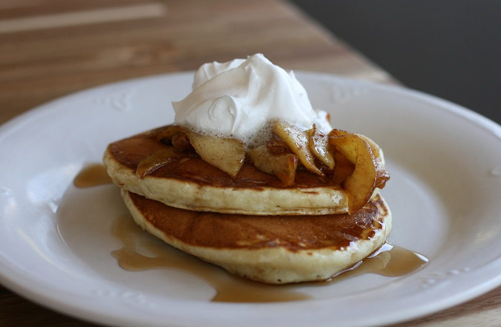 Fluffy pancake recipe topped with apples and whipped topping