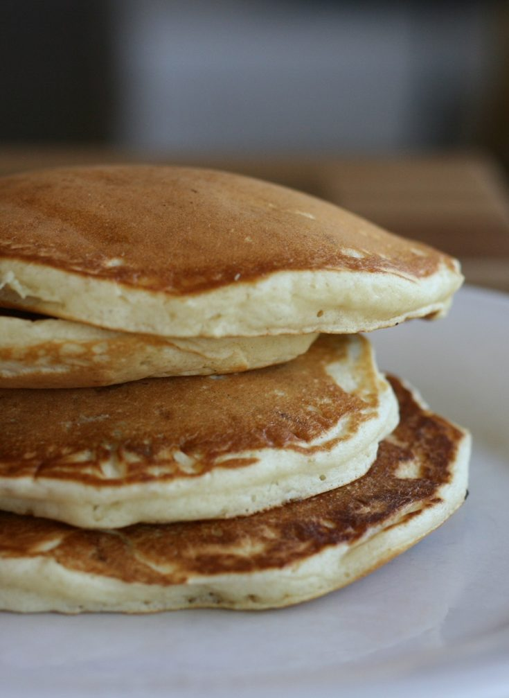Fluffy pancakes stacked up on a plate