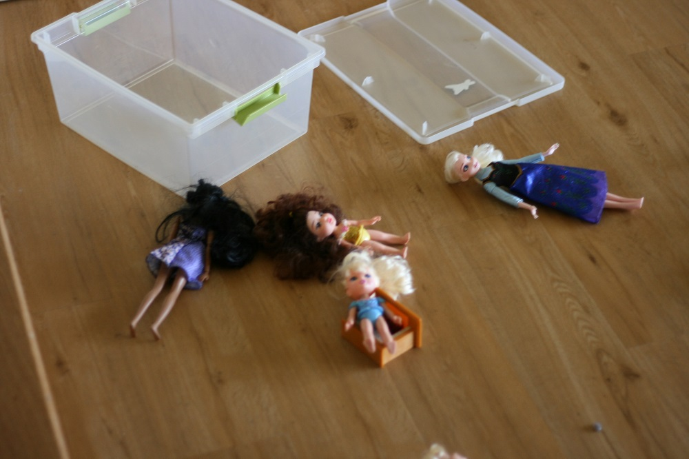 Dolls laying on the floor