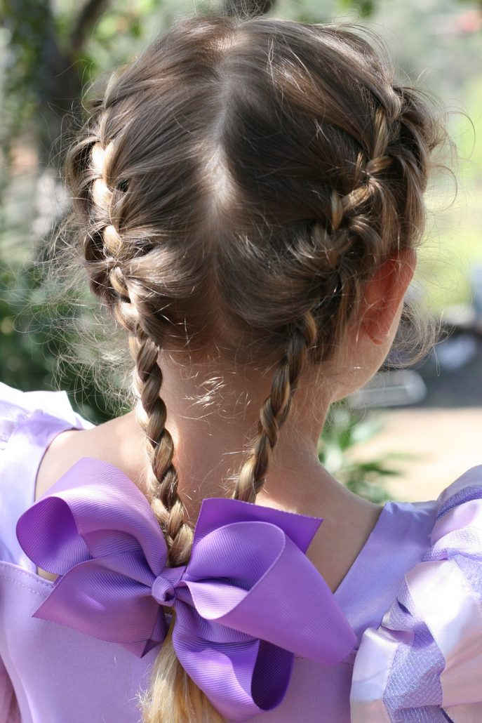 French braids with purple hair bow