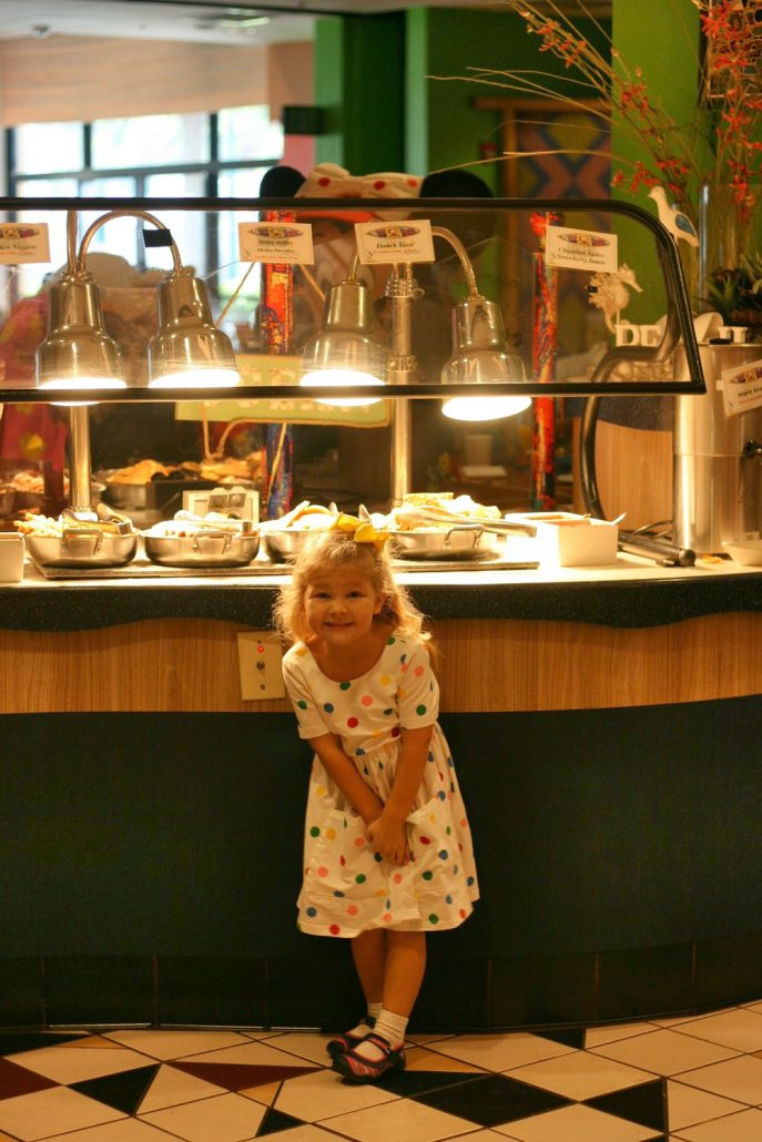 Little girl in front of PCH Grill buffet
