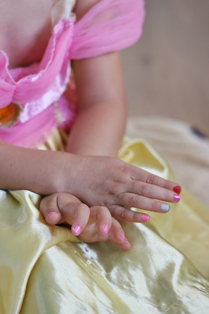 Little girl's hands wearing Piggy Paint fingernail polish