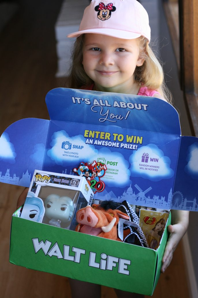 Little girl holding a Walt Life Kingdom box