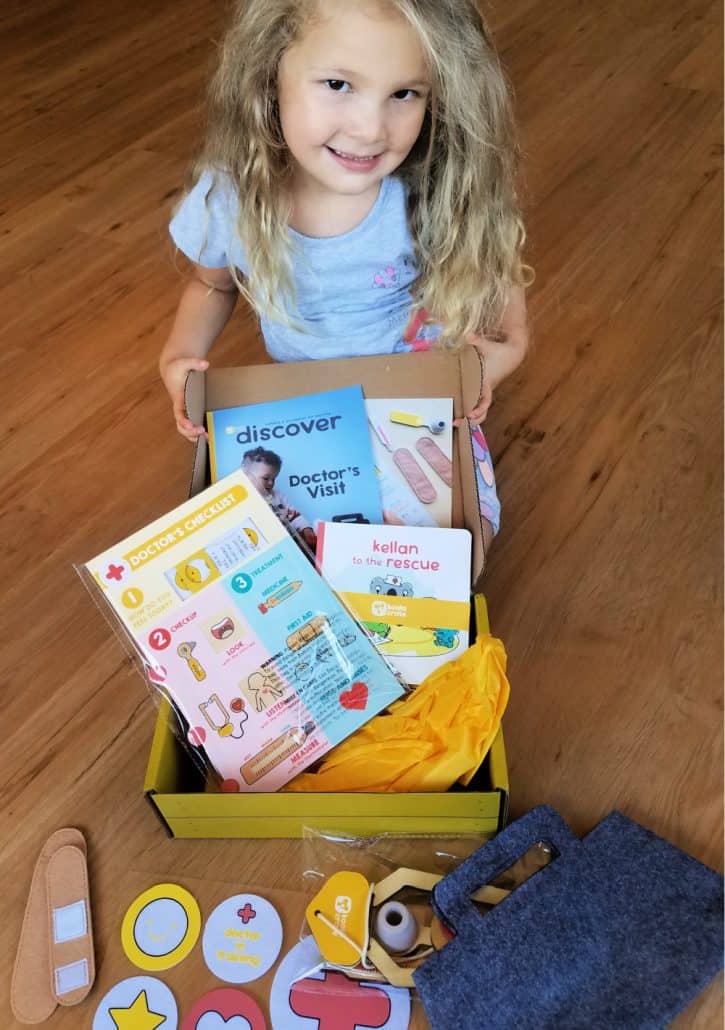 Little girl with open box from Koala Crate