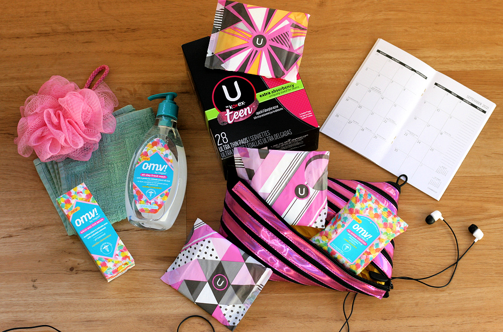 Teen period kit with cleansing products and pads coming out of a pink bag