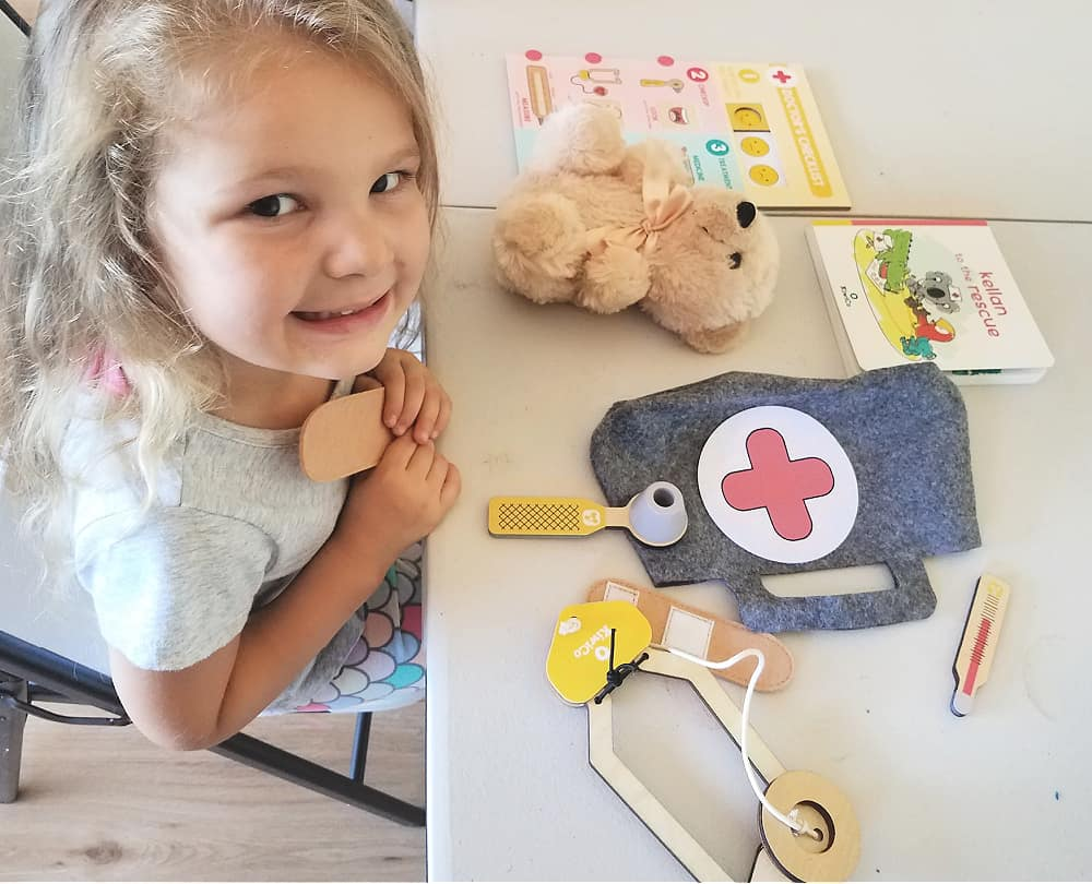Little girl with items from Koala Crate subscription box