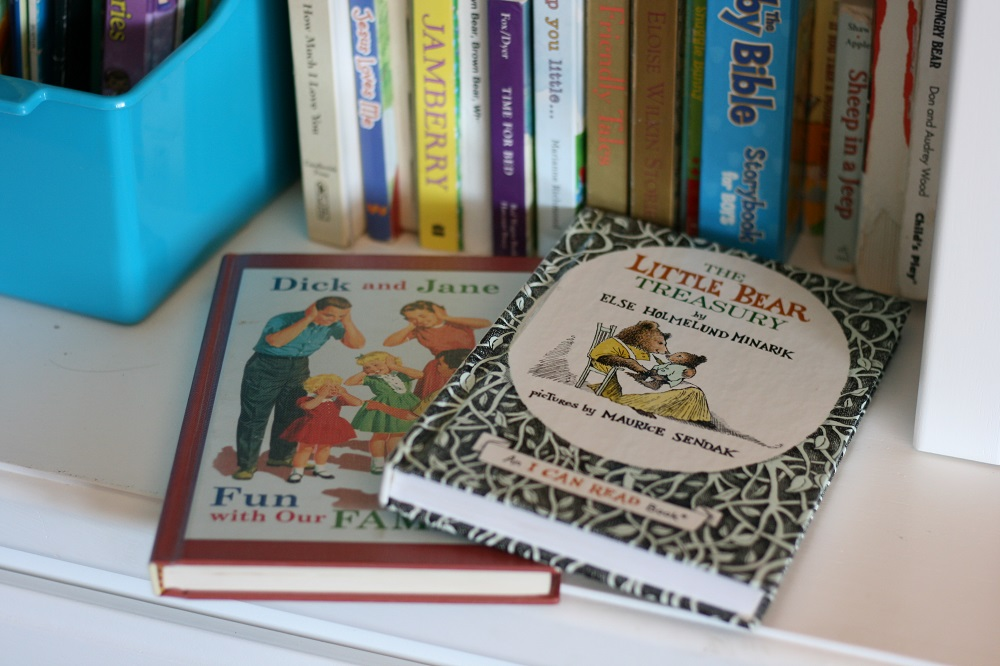 Kid's books on a shelf including Dick and Jane and Little Bear