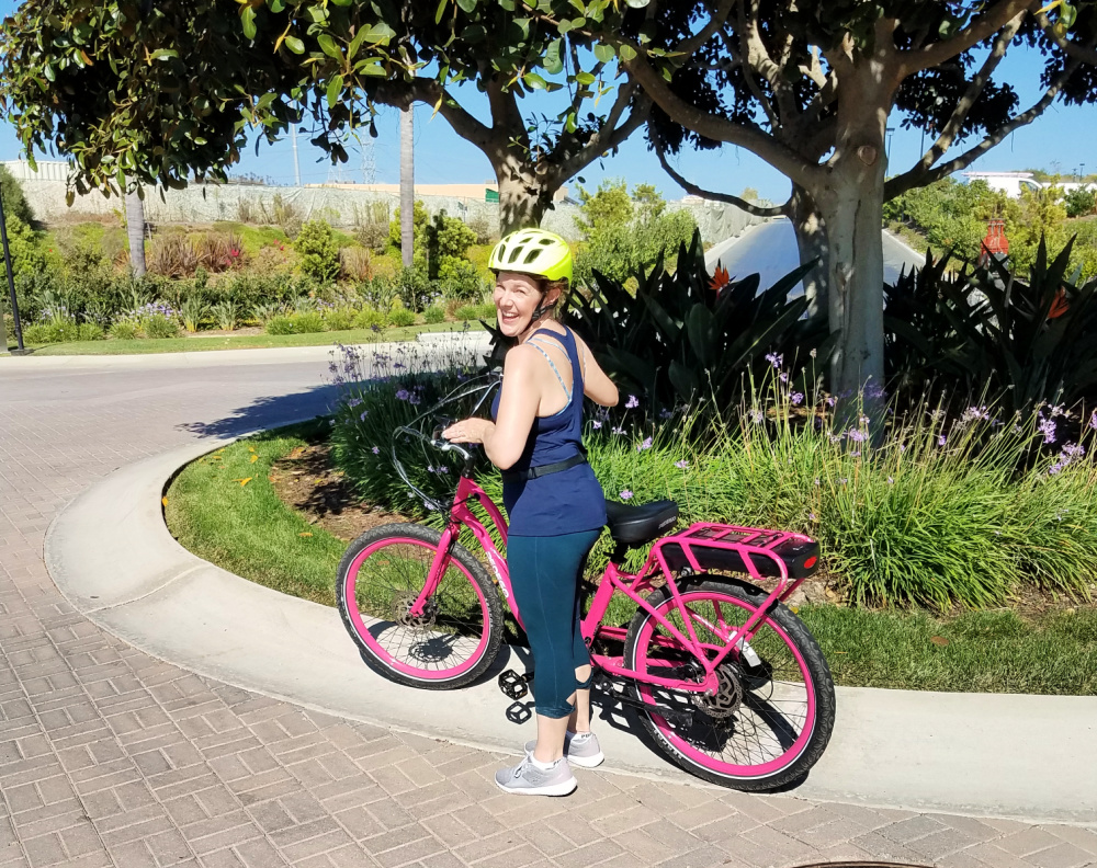Woman standing with electric bicycle