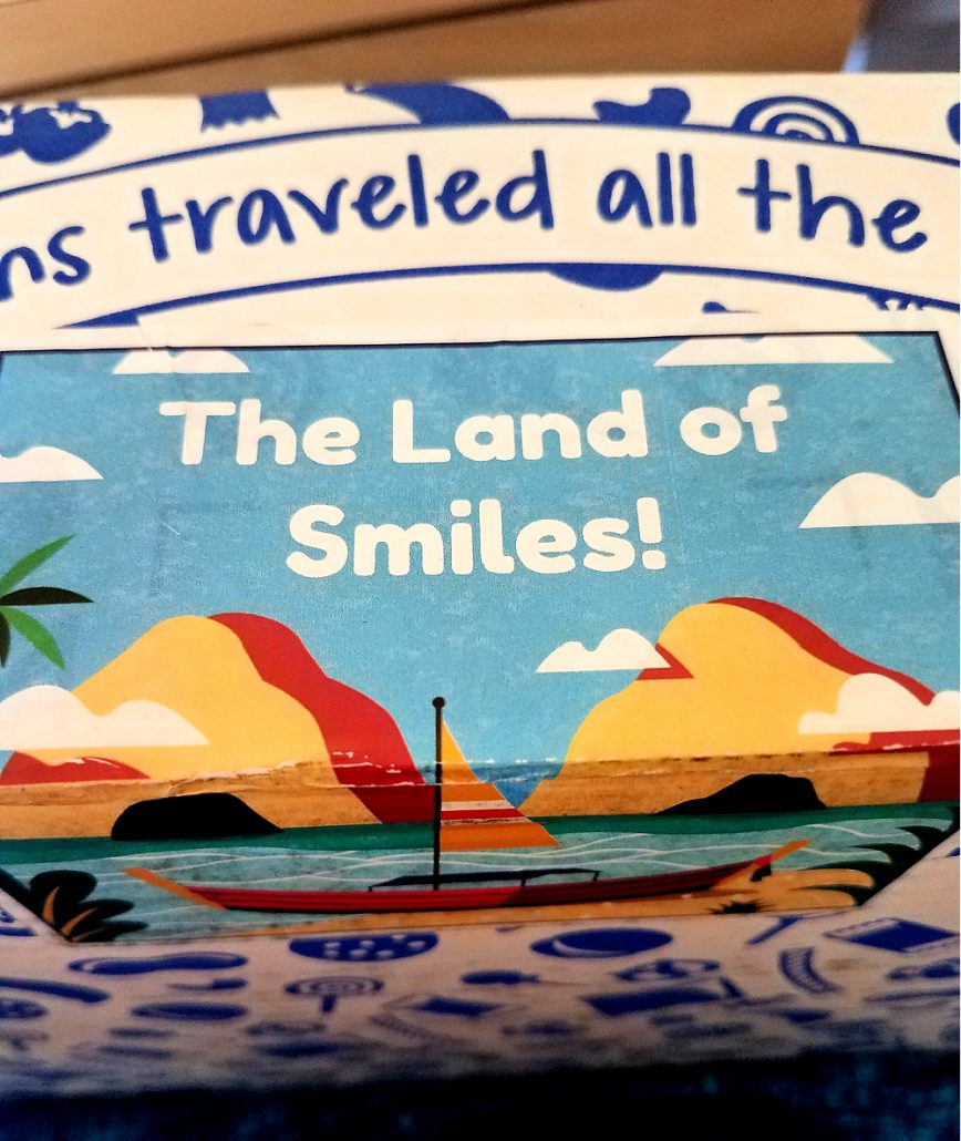 "Sticker on Universal Yums box from Thailand that says, ""The Land of Smiles"""
