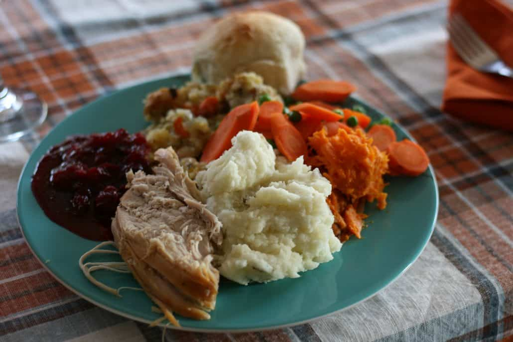 Thanksgiving dinner plate with turkey, cranberry sauce, potatoes and stuffing