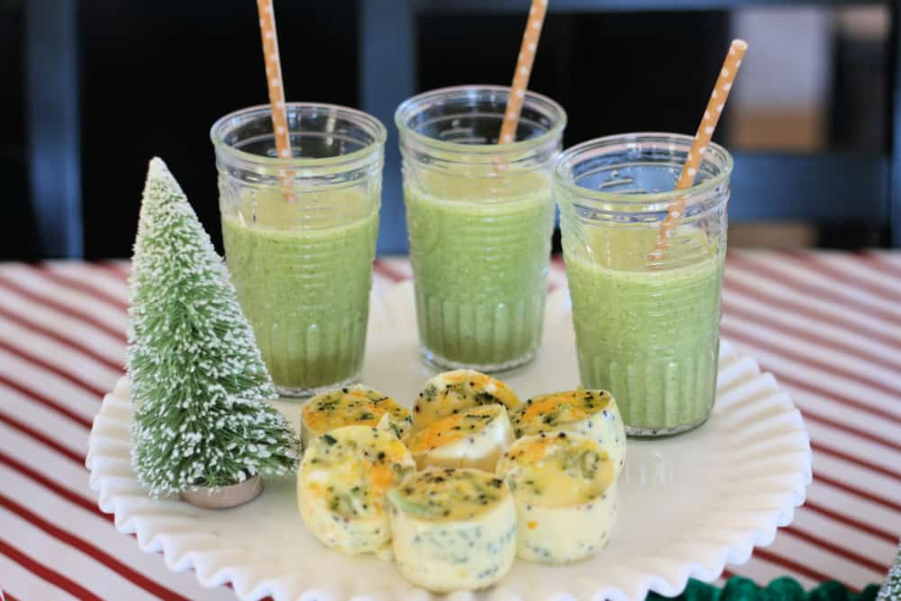 Green smoothies and egg bites on a white plate