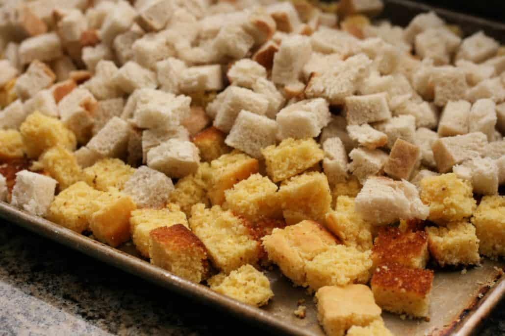 Cubes of dried bread on a baking sheet