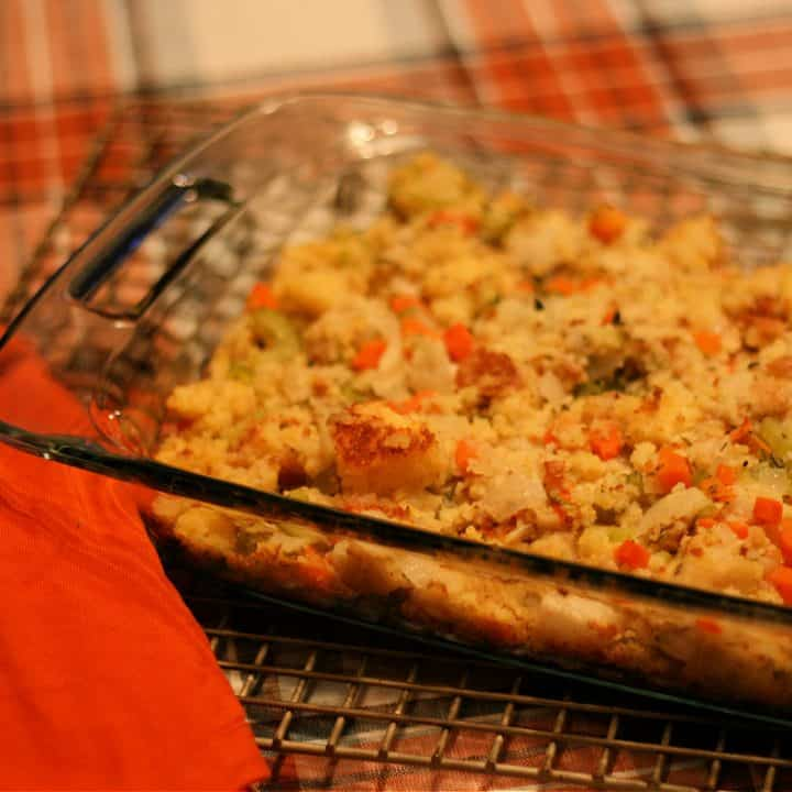 Homemade stuffing made with sourdough and cornbread in a casserole dish