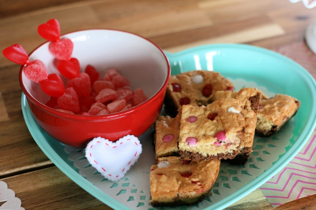 gummy heart candies in a bowl next to double decker brownies