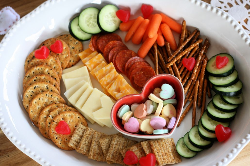Valentine's charcuterie board with cheese, crackers and veggies