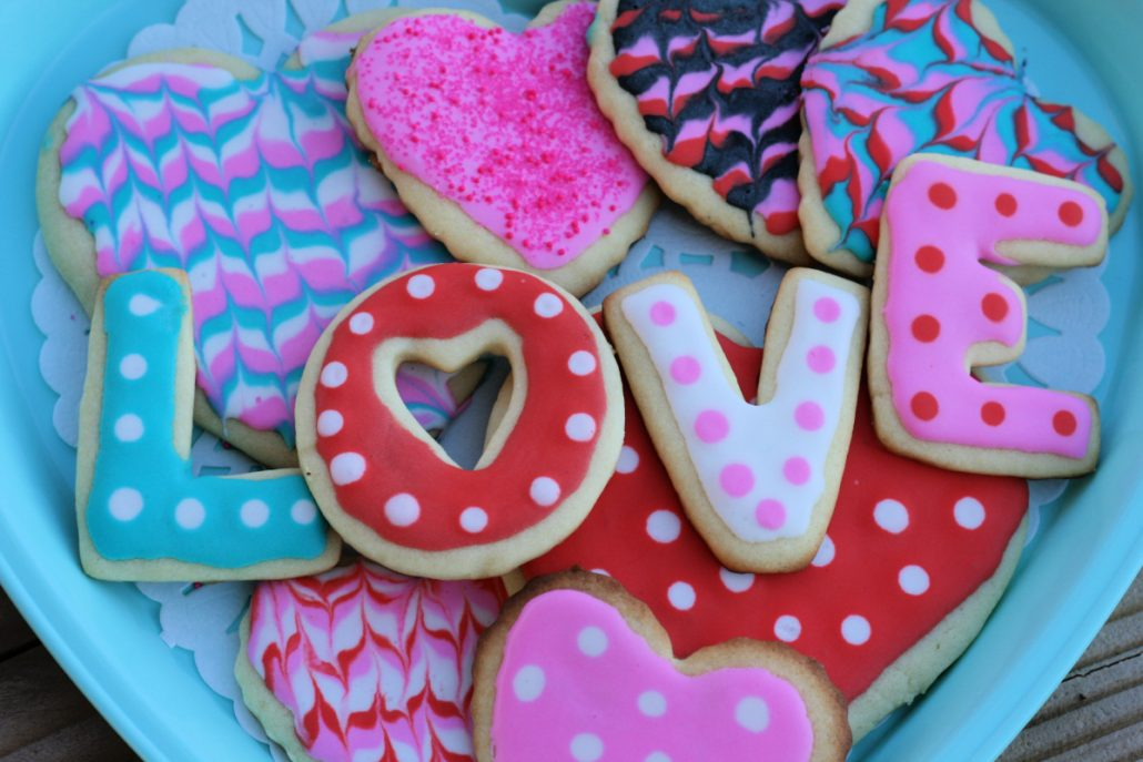 tray of Valentine's sugar cookies with the word LOVE spelled out