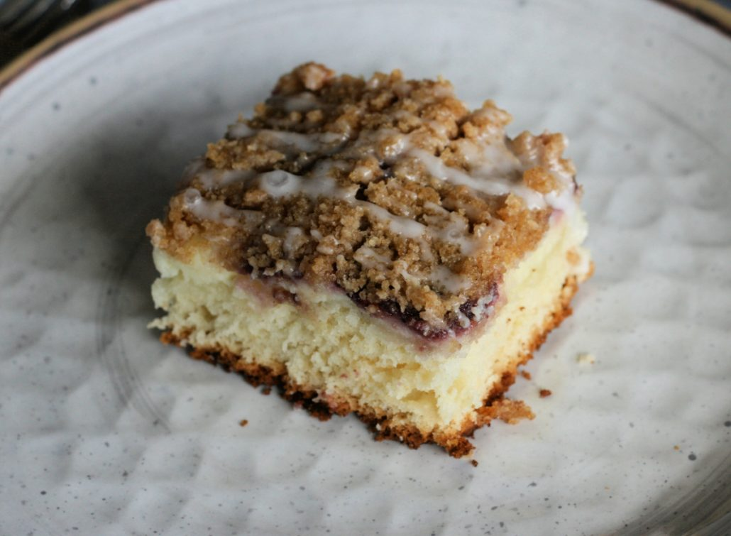 Slice of fruit filled cream cheese coffee cake