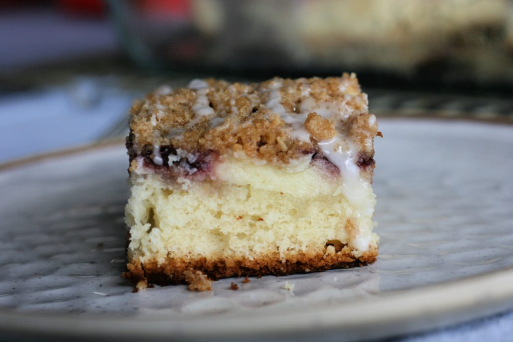 close up of cream cheese coffee cake slice on a plate