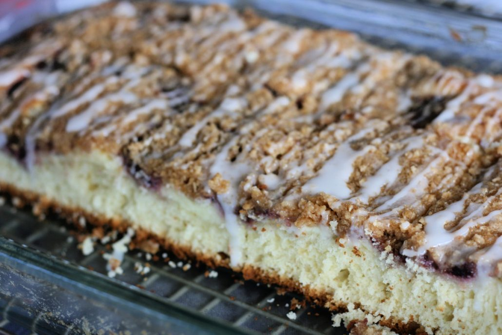 Pan of cream cheese coffee cake shown open on one side
