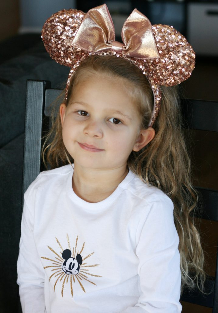 Girl wearing Mickey Fun Wheel Cricut shirt design