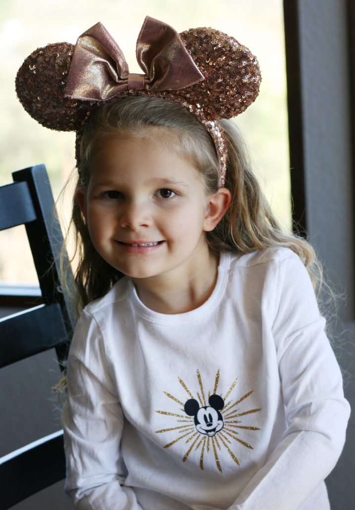 Little girl wearing Disney California Mickey shirt