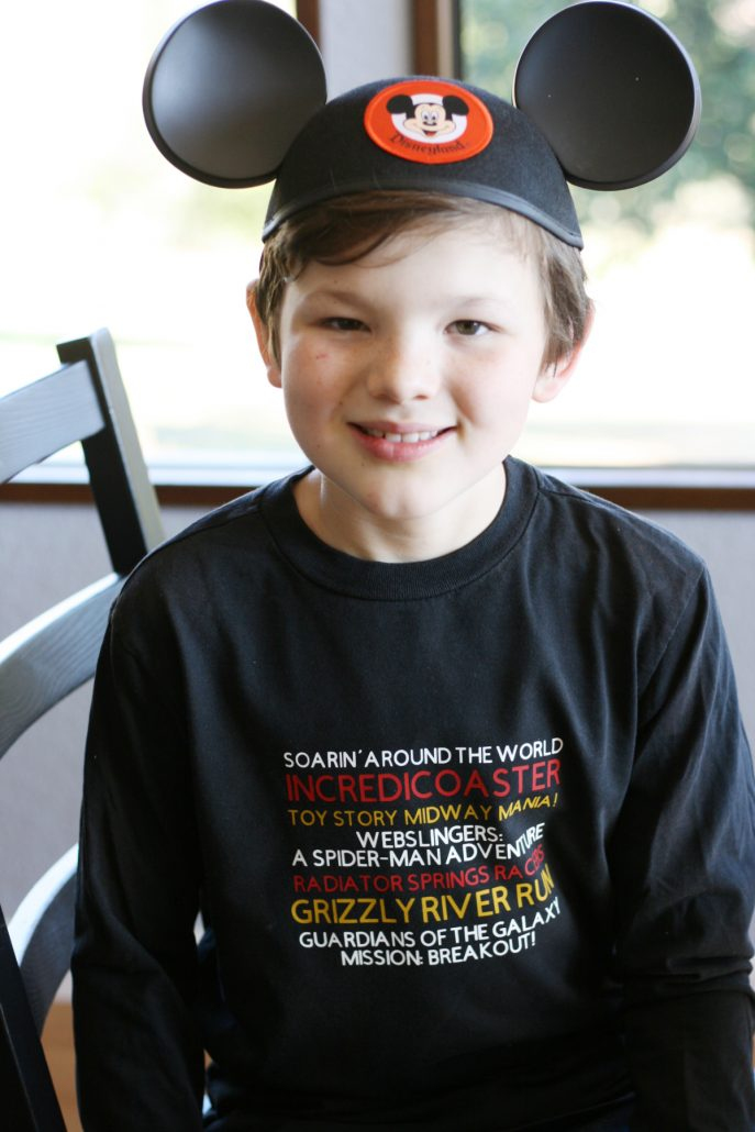 Boy wearing Disney California thrill ride design shirt