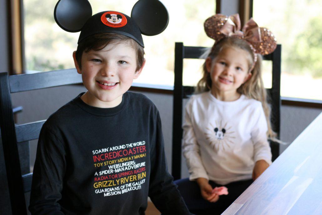 Two kids wearing Disney California Adventure shirts