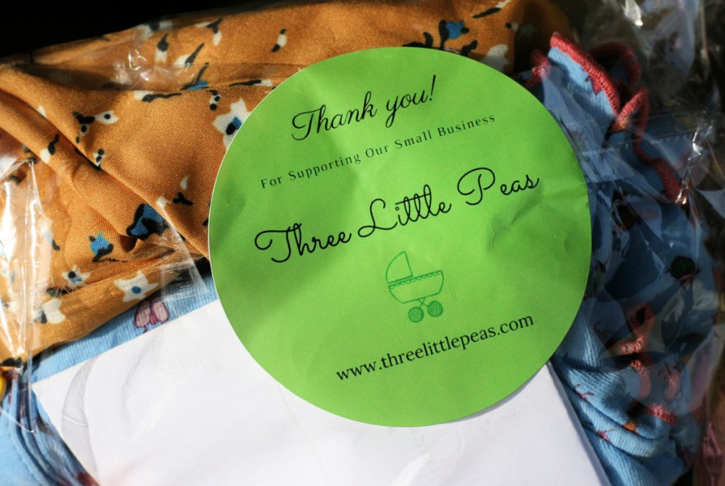 Label on bag from Three Little Peas resale shop