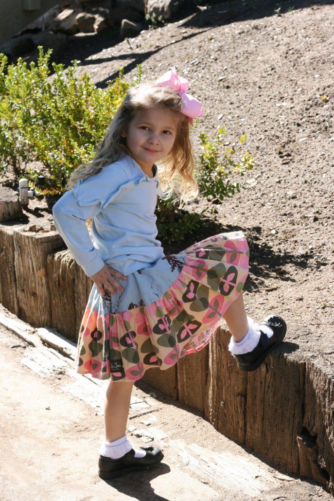 Little girl wearing a Matilda Jane skirt