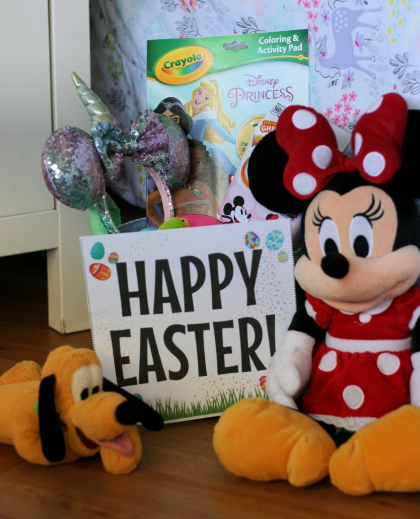 Happy Easter sign next to basket filled with toys and a Minnie plush