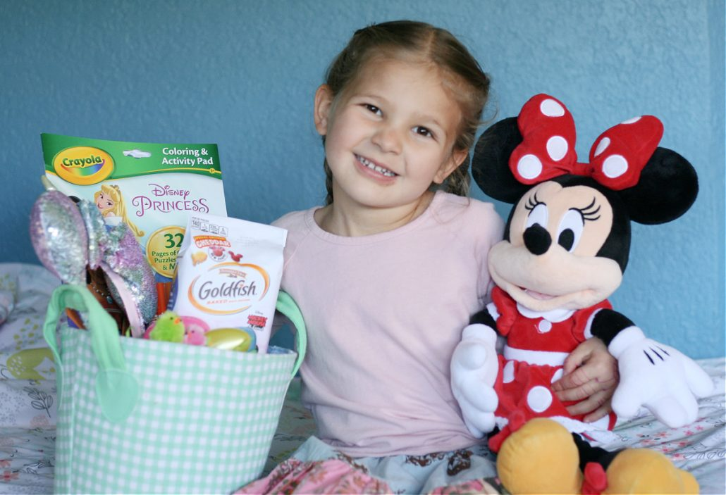 Little girl with Easter basket and Minnie toy
