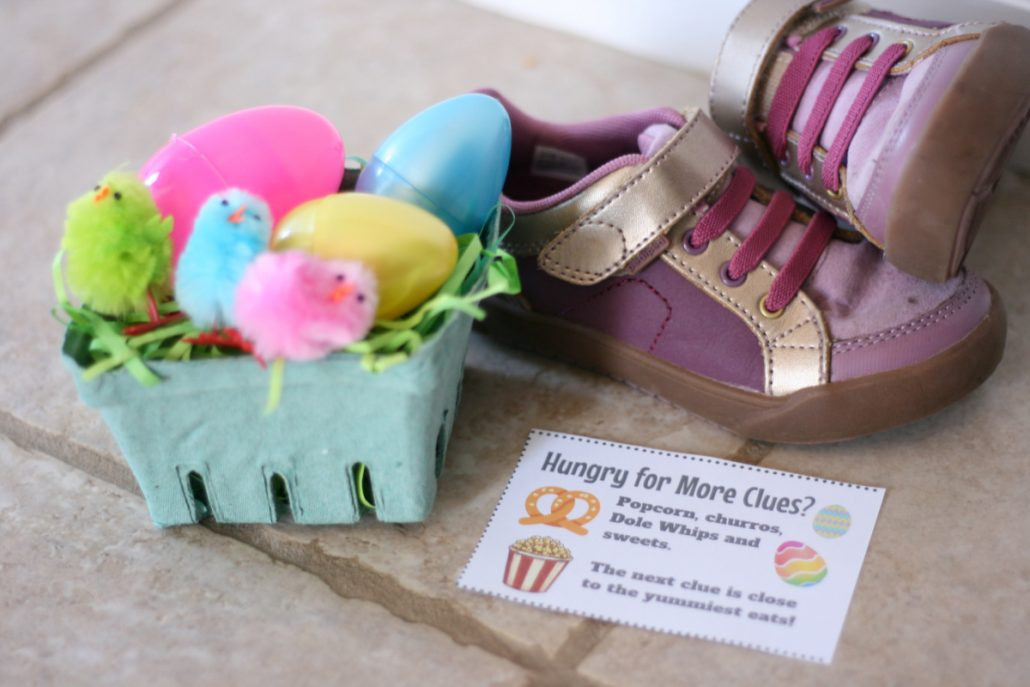 Small basket with plastic Easter eggs next to a pair of shoes