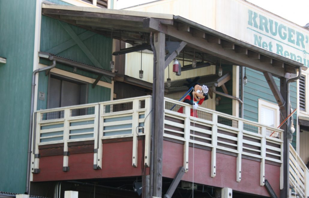 Max waving from balcony near Pacific Wharf