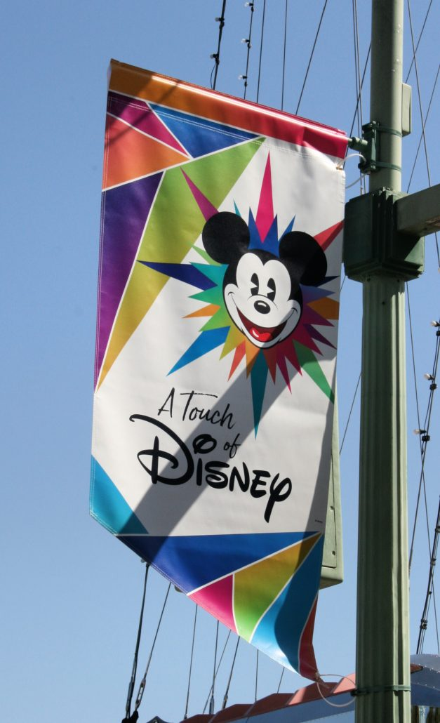 A Touch of Disney banner with Mickey's face and logo