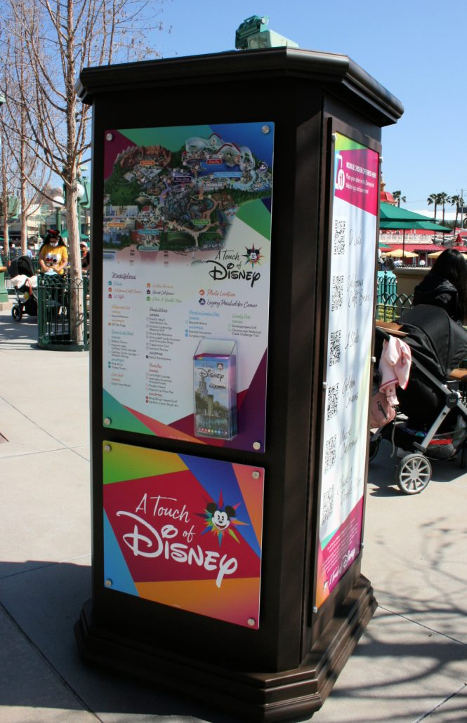 A Touch of Disney signage with guidebooks