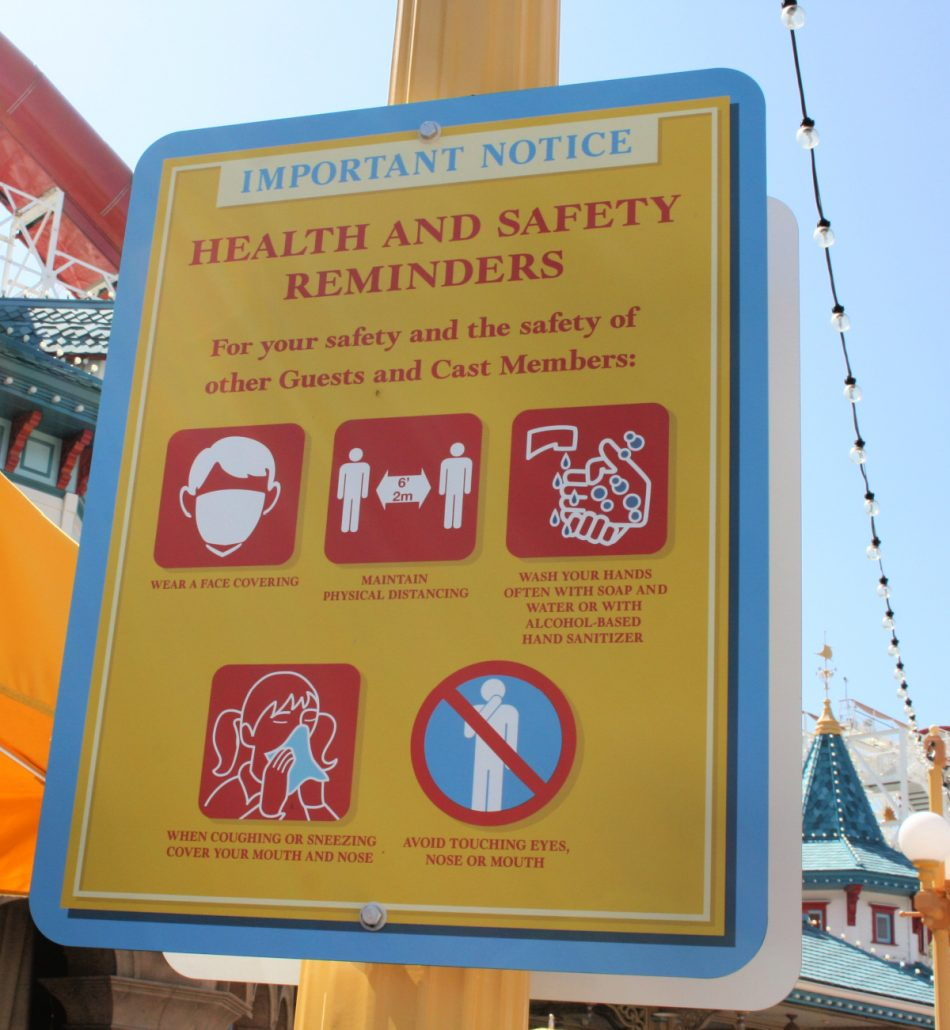 Health and safety reminder signage at Disney California Adventure