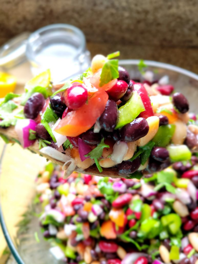 Close up of cold bean salad recipe on a spoon