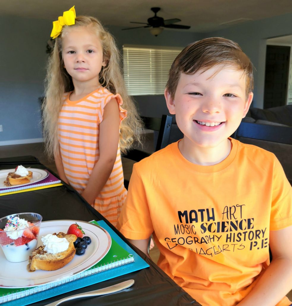 Kids sitting at table for back to school breakfast party