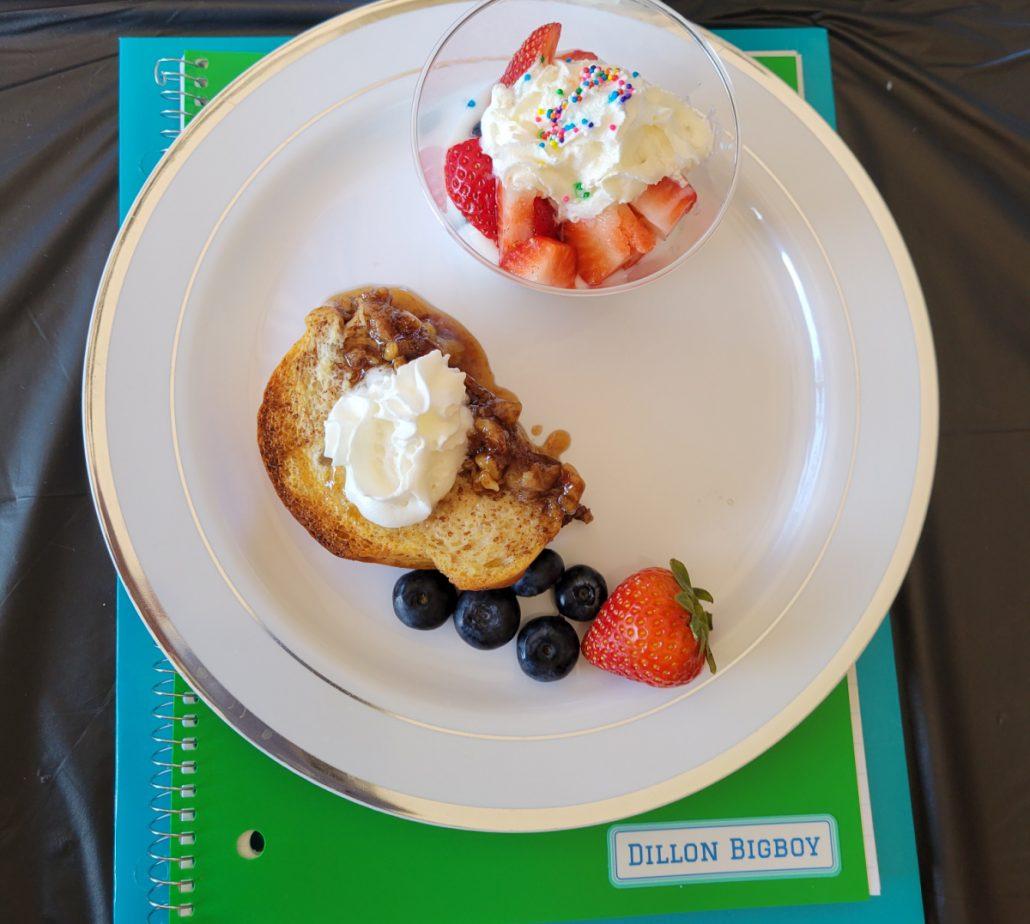 Breakfast plate on top of school folders