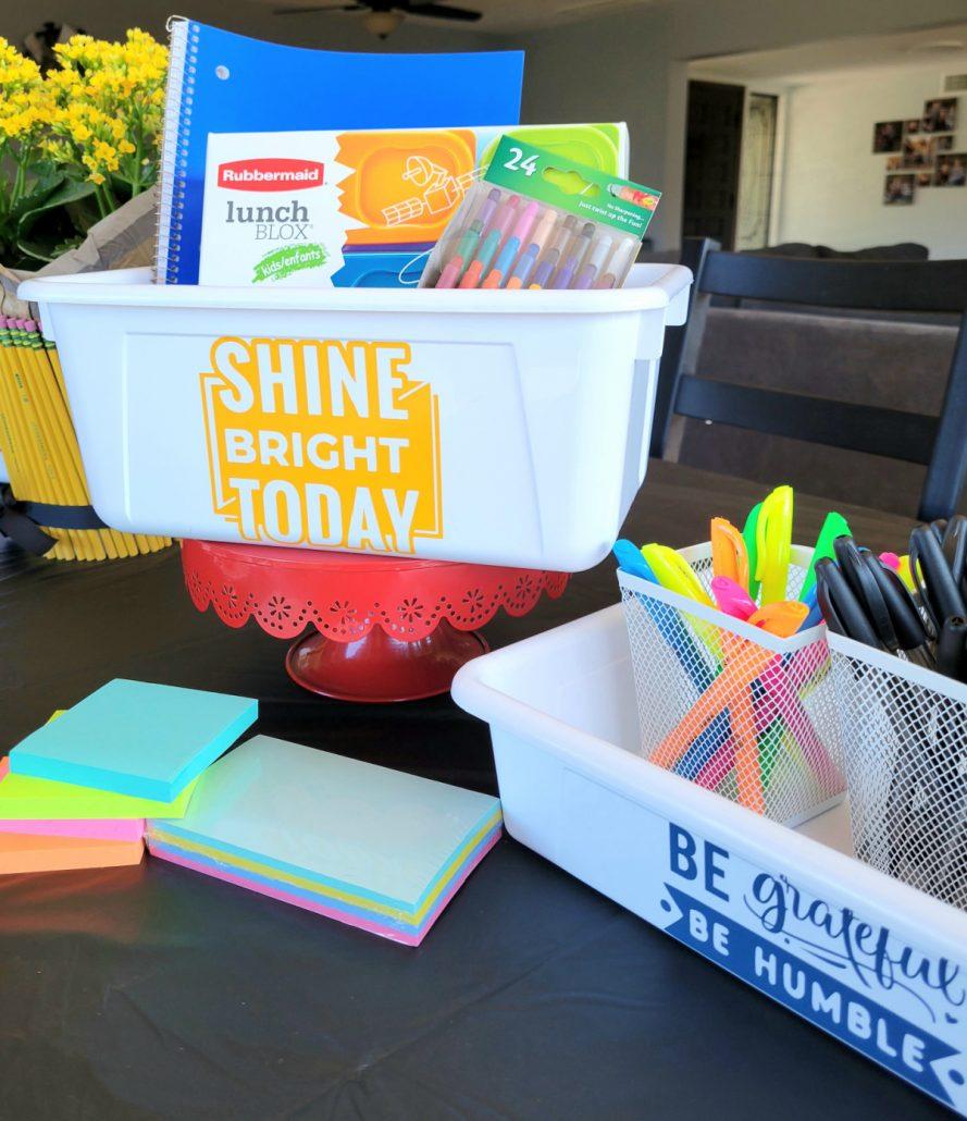 School supplies in a bin at a back to school breakfast party