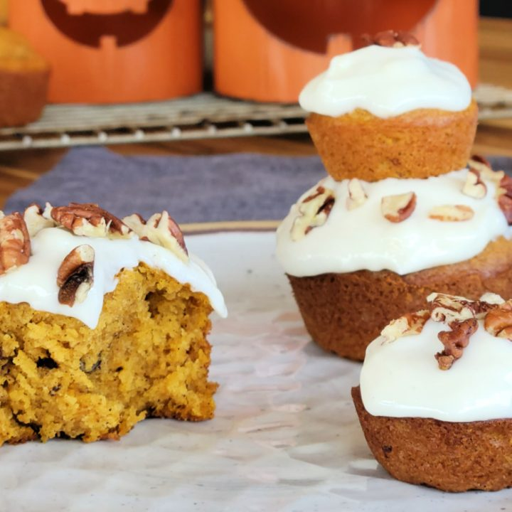 Pumpkin muffins with cream cheese icing and pecans